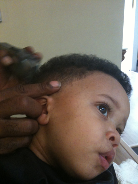 Monica's youngest son Romelo in the barber's chair