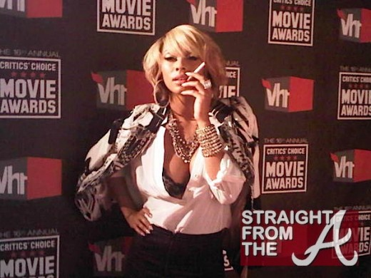 Keri Hilson smoking a cigarette (or weed)