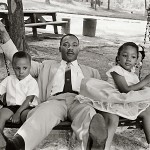 Martin-Luther-King&amp;children-on-swing