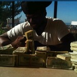 50 Cent flaunts stacks of cash as if they were Lego bricks on Twitter