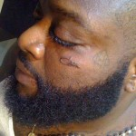 rick ross face tattoo