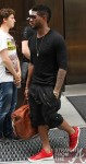 Usher-Cazal-x-Dita-902-Sunglasses-Brown-Leather-Duffle-Bag-RAF_Simons-Spring_Summer_2011_Red_leather-velcro-strap-Sneakers-1