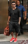 Usher-Cazal-x-Dita-902-Sunglasses-Brown-Leather-Duffle-Bag-RAF_Simons-Spring_Summer_2011_Red_leather-velcro-strap-Sneakers