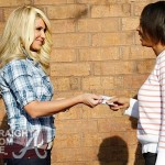 Kim Zolciak Pretends to Hand Out Vouchers