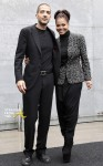 Singer Jackson and boyfriend Al Mana arrive to attend the Giorgio Armani Autumn/Winter 2013 collection at Milan Fashion Week
